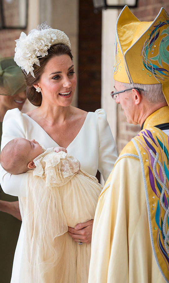 Even though conversation was going on around him between mom Kate and the Archbishop of Canterbury, Justin Welby, who performed his christening, Prince Louis dozed in his mother's arms.