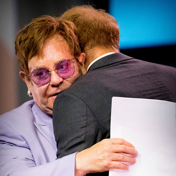 Day two of Harry's royal engagement in Amsterdam saw the prince attend the International AIDS Conference on July 25. There, Harry reunited with his longtime family friend Elton John, who runs the AIDS Foundation's Annual 'An Enduring Vision' Benefit each year. The duo embraced on stage.