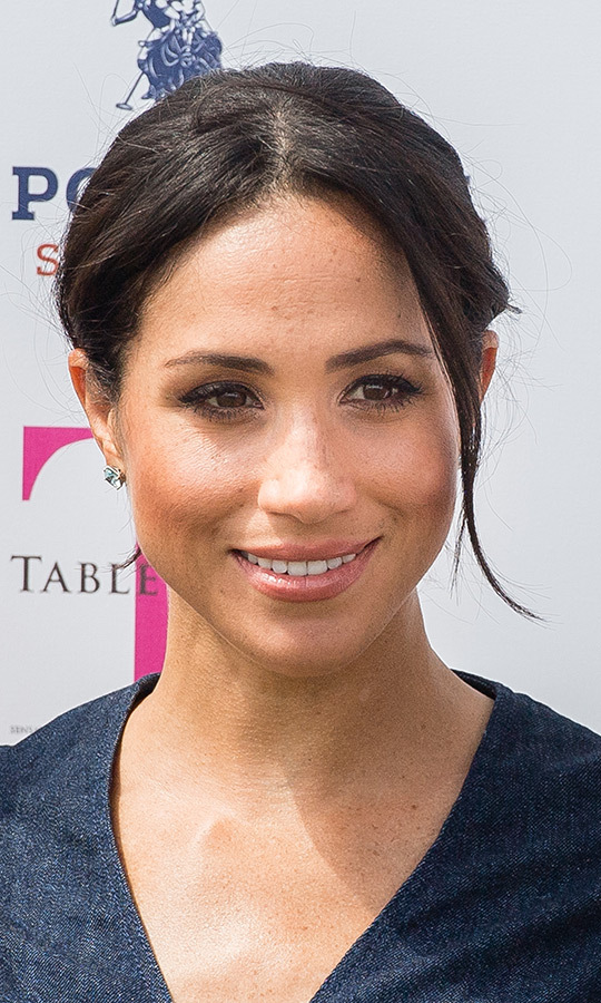 Meghan let her natural beauty shine once again, wearing her hair in her signature messy bun and opting for a swipe of blush, pink lips and some eyeliner and mascara. As always, her beloved freckles were on full display!