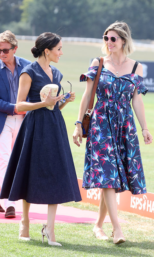 Meghan chatted with Nacho's wife Delfina, a fashion designer who looked stylish as ever in a patterned cold-shoulder dress with a brown leather bag and pink sunglasses.