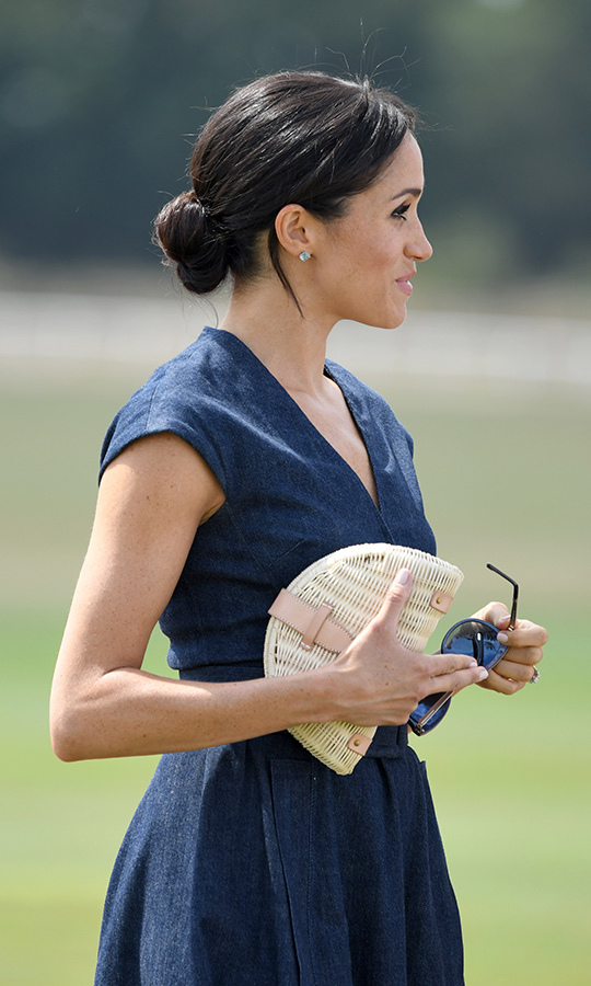 "Meghan's chic Raffia Fan Clutch from J Crew retails for just $115 (and is <a href=""https://www.jcrew.com/ca/p/womens_category/handbags/straw/fan-rattan-clutch/J0146"">currently on sale for $93!</a>)