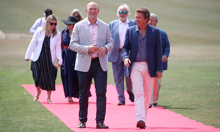 Mike Tindall arrived to take in the action from the sidelines. On his way in, Prince Harry's cousin chatted with Sentebale Chairman Johnny Hornby.