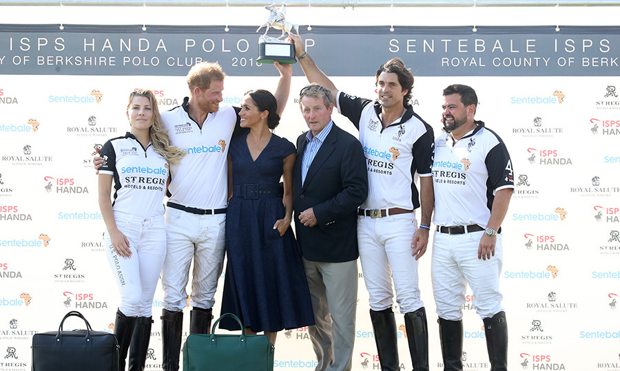 Meghan, who presented the trophy to the winning team, couldn't keep her eyes off her dashing husband!