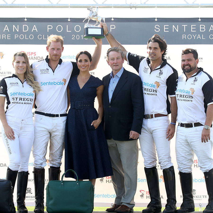 Prince Harry and Meghan pose with politician Enda Kenny and his teammates Ashley van Metre Busch, Nacho Figueras and Miguel Mendoza after winning the Sentebale Polo 2018 trophy.