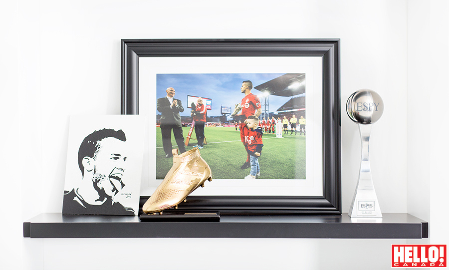 In a room that houses trophies like the MLS Golden Boot, a prized keepsake is a 2016 photo of Sebastian with his son on the TFC field.