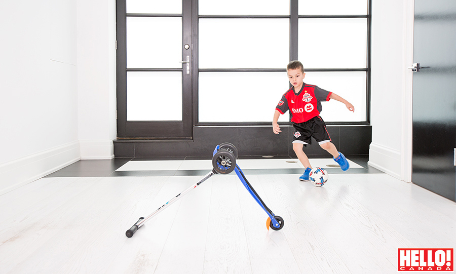Jacopo shows off his impressive soccer moves in a bright play room.
