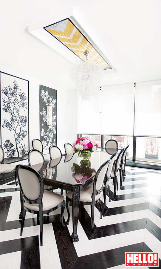 A chic black-and-white tiled floor through the dining room matches the colour palette of the kitchen.