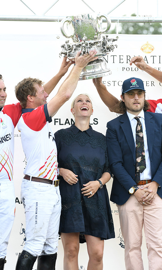 One month after welcoming her second daughter, baby Lena, Zara Tindall was out looking happy and healthy as she presented the trophy at the 2018 International Day Polo at The Royal County of Berkshire Polo Club on July 28 in Windsor. 