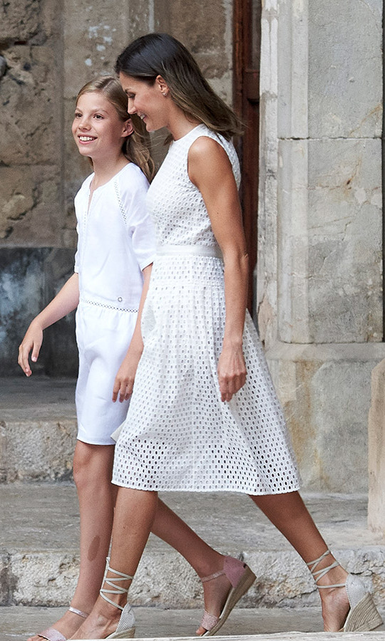 Queen Letizia and her younger daughter, Princess Sofia, were twinning in their crisp white outfits and wedge heels.