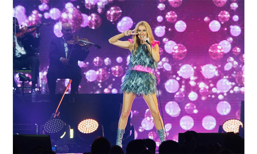 "Clad in her now-iconic frothy silver dress with pink embellishments, Celine gave fans the peace sign during her  first performance in Australia in a decade. ""G'day Sydney...How you going? - Céline xx…"" she captioned the photo, clearly as excited to be back Down Under as her fans were to have her! 