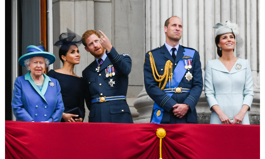 Prince Harry and Meghan Markle join the Royal Family on the balcony at Buckingham Palace to watch the RAF flypast. 