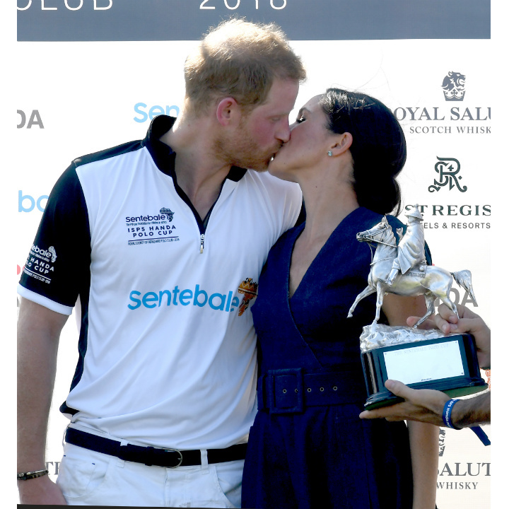 Meghan Markle congratulates Prince Harry on winning the Sentebale Polo cup with a kiss.