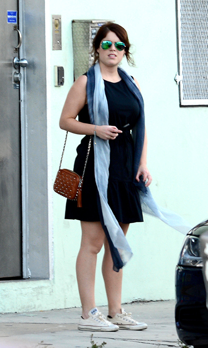 Looking cute and casual during Miami's Art Basel in 2014, Princess Eugenie wore a black dress, tie-dye scarf, brown bag and cream Converse while gallery hopping in the Wynwood area with a trio of friends.