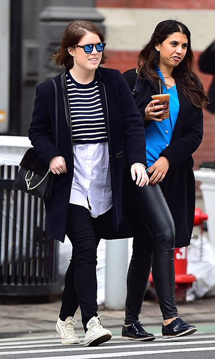 Royal off duty! Princess Eugenie was right on trend in New York's chic Soho neighbourhood in April 2015, wearing a black coat, a cropped striped sweater over a white button-up shirt, black jeans, a Chloe shoulder bag and cream sneakers.