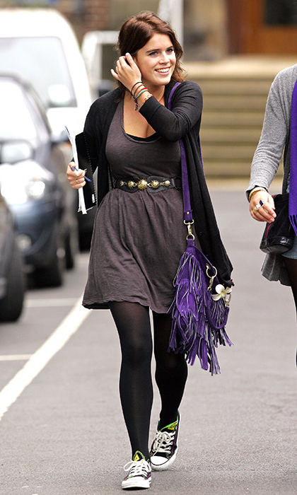 For her first day of classes at Newcastle University in 2009, Princess Eugenie looked like your average student, notebook in tow! She wore a funky fringed purple bag, brown jersey dress with an embellished belt nipping her waist, black tights and black Cons with green piping. 
