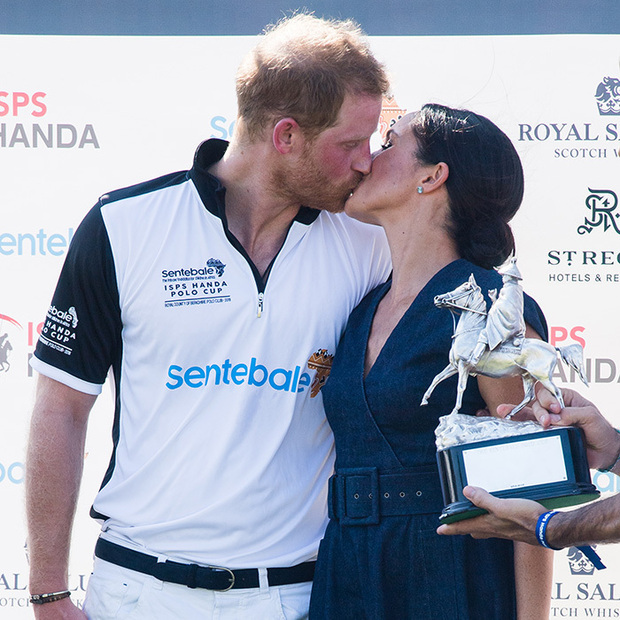 Taking after the iconic photos of Princess Diana and Prince Charles locking lips at past polo matches, Meghan and Harry shared a sweet smooch on July 26 at the Sentebale Polo Match.
