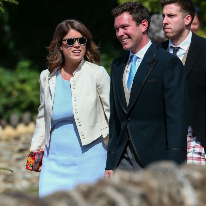 Princess Eugenie looked every bit the fashion maven in a pastel blue dress, white jacket and the coolest sunglasses.