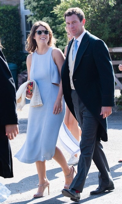Princess Eugenie took off her little white coat as the sun shined down on the wedding day.