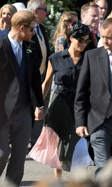 The couple chatted as they walked towards the church.