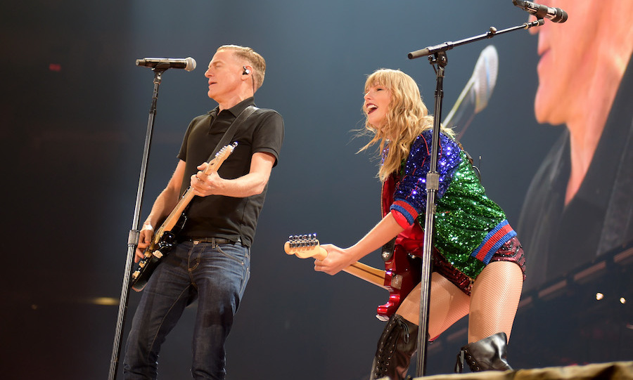 "Taylor Swift heated up her Toronto show on Aug. 4 with a lively rendition of ""Summer of '69,"" with none other than Canadian legend, Bryan Adams! According to <a href=""https://www.billboard.com/articles/columns/pop/8468681/taylor-swift-bryan-adams-summer-of-69-live-toronto""><strong><em>Billboard</em></strong></a>, the singer picked up her electric guitar to start strumming, speaking to the crowd: ""It's just one of my favorite songs ever written — it's not one of mine, but I was wondering, like, you guys have been singing so loud all night, but I really wanted to see how loud it could be, right?"" After finishing the first verse, Bryan appeared from the stage trap door to pick up the song with Taylor, <a href=""https://www.instagram.com/p/BmFjqHOlYgB/?taken-by=taylorswift""><strong>and the crowd went wild</strong></a>!