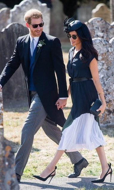 Though they spent part of the day apart as Prince Harry tended to his best man duties, the couple enjoyed a sweet moment after close friend Charlie van Straubenzee's wedding to Daisy Jenks. The duke held on tightly to his wife and birthday girl's hand and gave her a loving smile.
