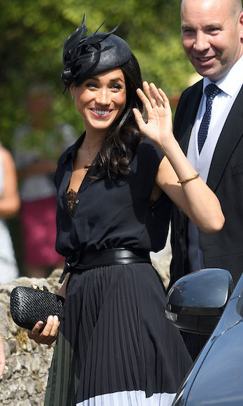 For royal family friend Charlie van Straubenzee's wedding to Daisy Jenks, Meghan turned to one of her go-to milliners for  a chic topper. The black Philip Treacy design featured an asymmetrical beret-style base with wisps of coiled fabric just above her ear. She paired the piece with a Club Monaco blouse and pleated colour-block skirt, her favourite Aquazzura pumps and a Kayu clutch. 