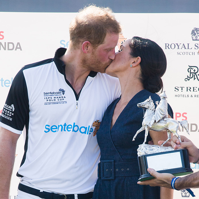 "A kiss for the winner! The Duchess of Sussex gave her duke a smooch at the 2018 Sentebale Polo Cup in July after handing out the trophy to Prince Harry's team, which included pro polo pal Nacho Figueras. Nacho later joked about the kiss, captioning a photo ""when you wished the trophy would turn into a violin"" where he's standing in the frame alongside the couple. 