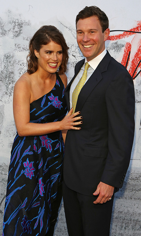 Princess Eugenie and her fiance Jack Brooksbank were all smiles at the Serpentine Gallery's summer party in 2018, where the royal placed a loving hand on her husband-to-be's chest while the duo posed for photos. 