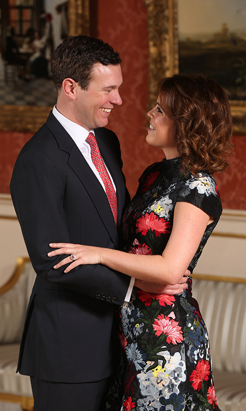In one of their official engagement photos, Princess Eugenie and Jack Brooksbank gaze adoringly into one another's eyes while in a loving embrace. The photo, taken in the Picture Gallery at Buckingham Palace and shared with the public in Jan. 2018, also shows off Eugenie's stunning engagement ring, a pink padparadscha sapphire surrounded by diamonds. 