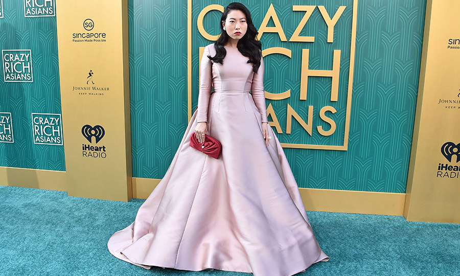 Hot on the heels of her promo tour for <em>Ocean's 8</em>, Awkwafina was dressed to impress in a show-stopping pink Reem Acra confection. The actress offers ample comic relief in the film as Goh Peik Lin.