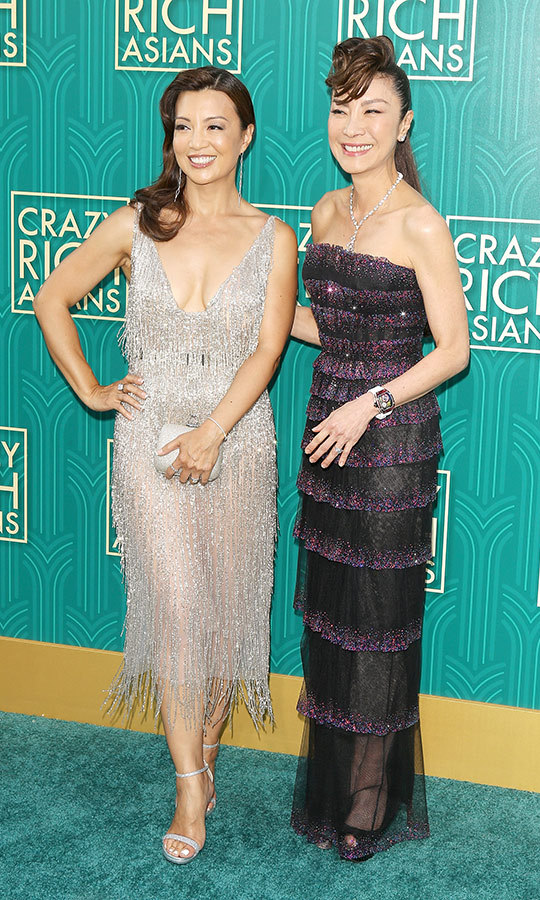 Actresses Ming-Na Wen and Michelle Yeoh brought the glitz to the jade carpet! Ming-Na slipped into a shimmering silver number while Michelle, who took on conniving Eleanor Young in the film, opted for tiered Armani Prive. 