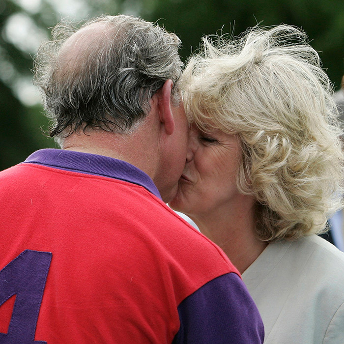Another royal athlete, another sweet smooch! Camilla, Duchess of Cornwall planted one on her husband, Prince Charles, after he played polo at Cirencester in 2005.