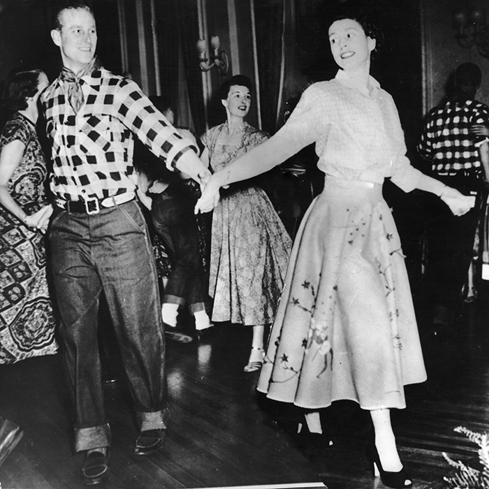 Oh, Canada! The Duke of Edinburgh spun his wife, then Princess Elizabeth, around the floor at a square dance held in their honour in Ottawa in 1951.