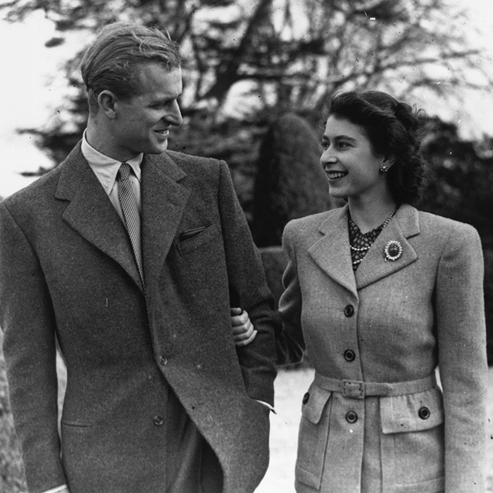 In 1947, then Princess Elizabeth held her new husband Prince Philip close as the two enjoyed a walk while on their honeymoon at Broadlands.