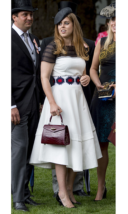 Rocking that Old Hollywood glamour Royal Ascot in 2017 thanks to a full-skirted dress, crocodile handbag and beret.