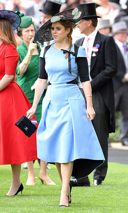 Princess Beatrice got in the spirit on Ladies Day at Royal Ascot in 2017, wearing a figure-flattering high-low dress in blue and black with a wide-brimmed hat and a sweet ribbon in her hair. Add a Chanel handbag and she's a lady through and through.