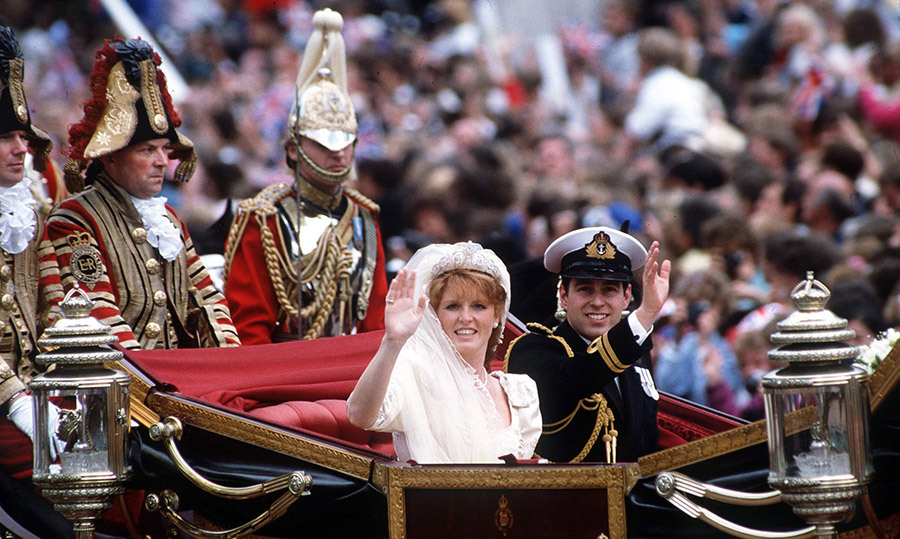 The newlyweds enjoyed their carriage procession surrounded by royal watchers.