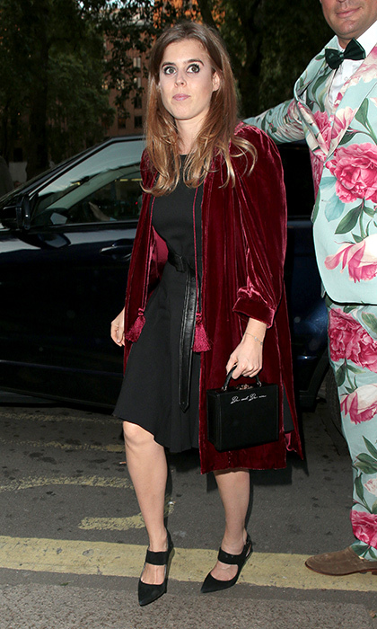 Looking every inch the fashionista, Beatrice paired a belted black dress with a tasseled burgundy velvet robe and black cutout pumps to celebrate the Chelsea Flower Show in May 2018.