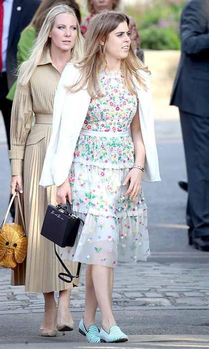 The princess was sweet as can be at the Chelsea Flower Show in May 2018, where she paired a delicately tiered floral dress with a white blazer and funky striped slippers.