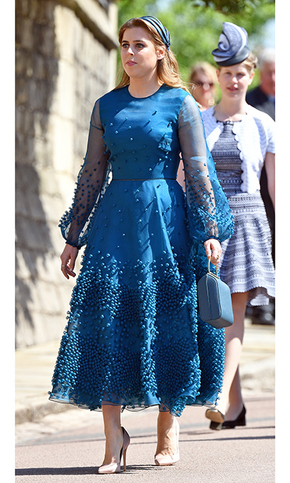 For Prince Harry and Meghan Markle's royal wedding on May 19, 2018, the royal donned a striking teal confection by Roksanda Viola that featured sheer voluminous sleeves and tons of beading detail. She topped it off with a multi-strand Stephen Jones headpiece.
