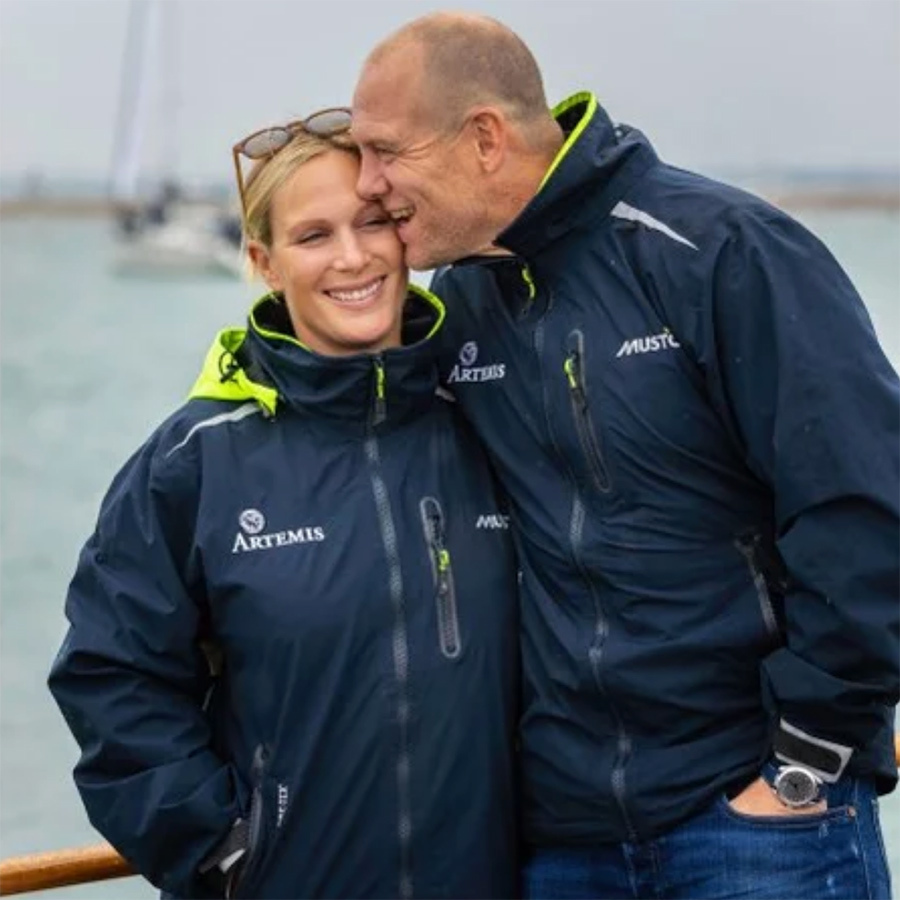 Zara and Mike Tindall are officially the king and queen of royal PDA! The duo put on the sweetest display at the Cowes Week Regatta on Aug. 9, 2018 when Mike playfully kissed and nipped his wife's face. Despite the rain, the parents of two were all smiles as they held on tightly to one another. 