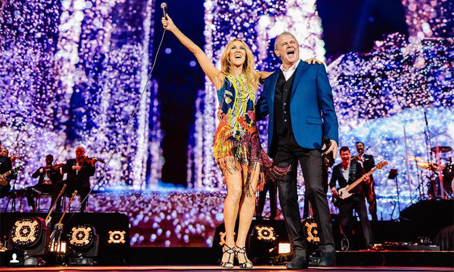"Celine brought a very special guest and local icon to the stage in Australia! She captioned the photo: ""I've wanted to sing John Farnham's ""You're the Voice"" on my tours for so many years, and it's been so great to finally do it on this tour.  But I still can't believe that I got to perform it with the one-and-only,  John Farnham!  I will never forget this, the thrill of a lifetime.  John, thank you for your incredible talent, you're amazing.  I love you! Thank you, Melbourne! - Céline xx…""