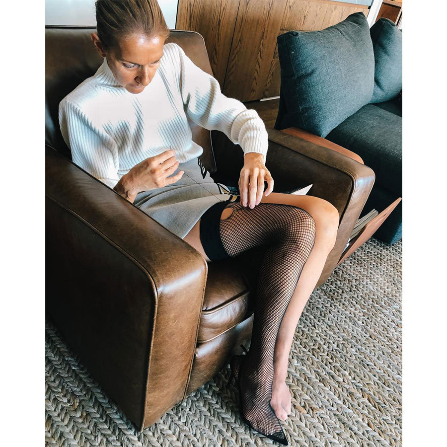 "The witty singer paid tribute to her mother, Thérèse, by showing off her darning skills! ""Thank you Mom, you taught me well..."" she captioned this photo where she's sewing up a hole in her fishnet stockings. 