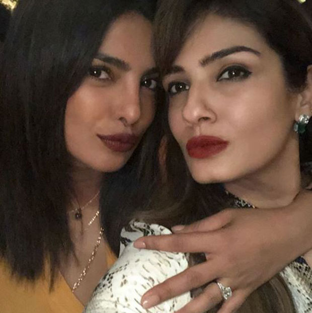 "For the first time since her and Nick Jonas's engagement rumours started, Priyanka Chopra has shown off what appears to be a massive engagement ring! The <em>Quantico</em> star was in Mumbai, India for an event with her Bollywood star friend Raveena Tandon, where they posed for a glamorous photo together for Raveena's Instagram account. ""Peecee and I getting our pouts in order,"" she captioned the photo.