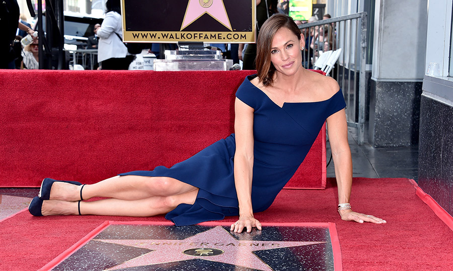 "After 23 years in the movie business, Jennifer Garner finally received her star on the Hollywood Walk of Fame on Aug. 20! The actress showed off her athletic physique – thanks to her upcoming action-packed film <em>Peppermint</em> – in a stunning blue dress and matching suede heels. The <em>13 Going On 30</em> actress and mother of three was joined by her industry friends Steve Carell, Bryan Cranston and Judy Greer to celebrate the exciting day, about which she told <a href=""https://variety.com/2018/film/features/jennifer-garner-walk-of-fame-alias-1202903262/""><strong><em>Variety</em></strong></a>, ""It's all been a big accident."" 