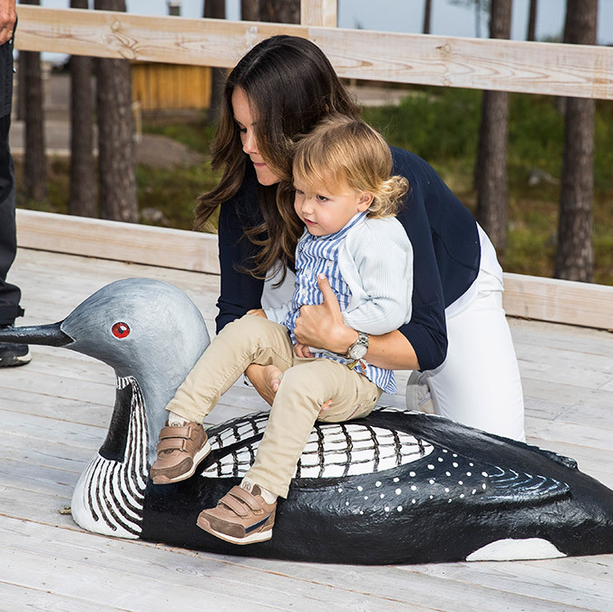 The energetic toddler got to sit on an oversized model of a duck while opening his eponymous viewpoint.