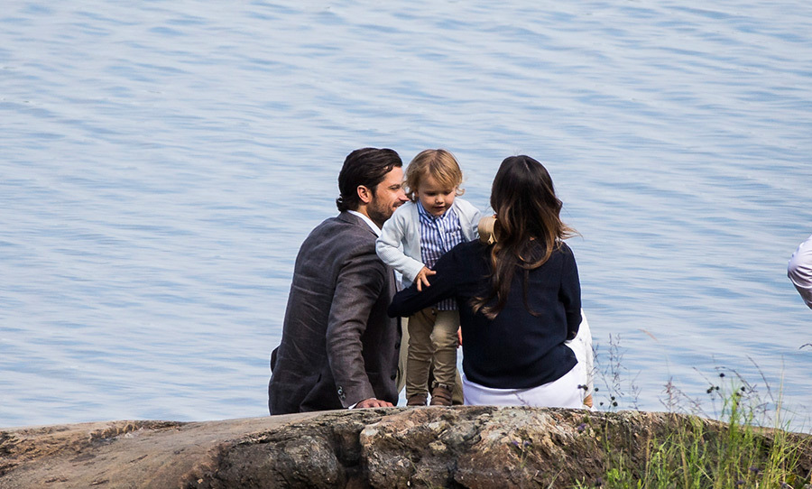 The trio shared a moment alone by the water, enjoying the stunning scenery.