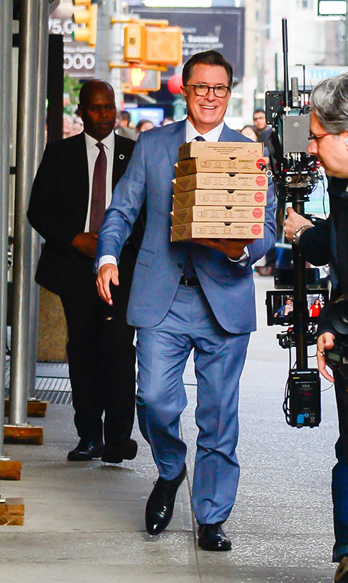 Pizza party! Stephen Colbert was spotted outside <em>The Late Show With Stephen Colbert</em> on Aug. 15 with a stack of pies.