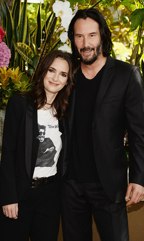 Hollywood veterans Winona Ryder and Keanu Reeves stopped for a photo at the <em>Destination Wedding</em> premiere on Aug. 18.
