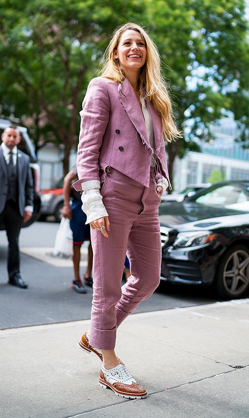 This outfit definitely <em>suits</em> her! Blake Lively showed off her sartorial savvy in the Big Apple on Aug. 20.